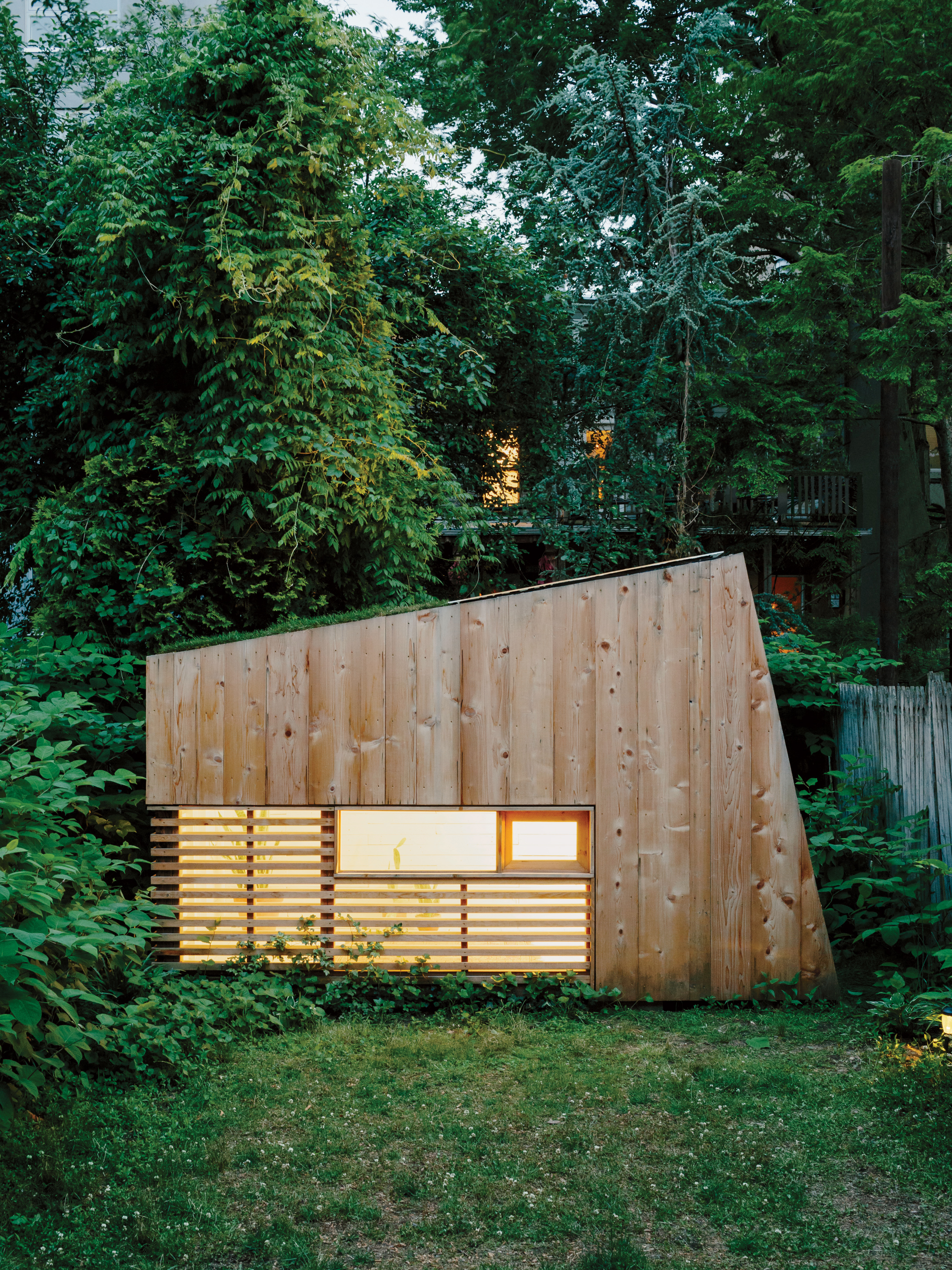 Modern Brooklyn backyard studio with plexiglass skylight, green roof, and cedar cladding facade