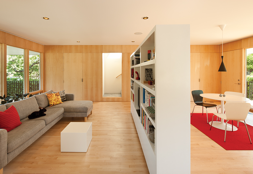 Affordable Portland home with custom bookshelf room divider between living and dining