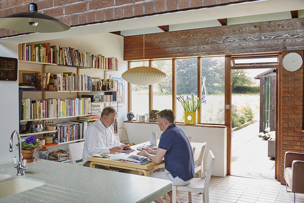 Eat-in kitchen in England with a George Nelson pendant light
