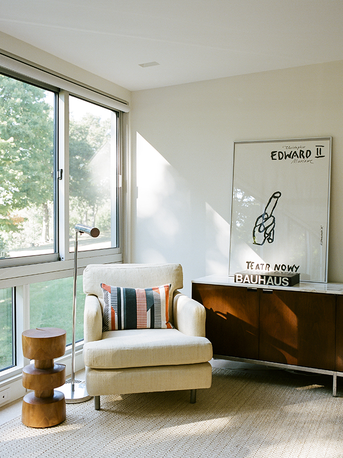 Modern guesthouse renovation in New York with Wormley armchair and chris Lehrecke pedestal in the living room