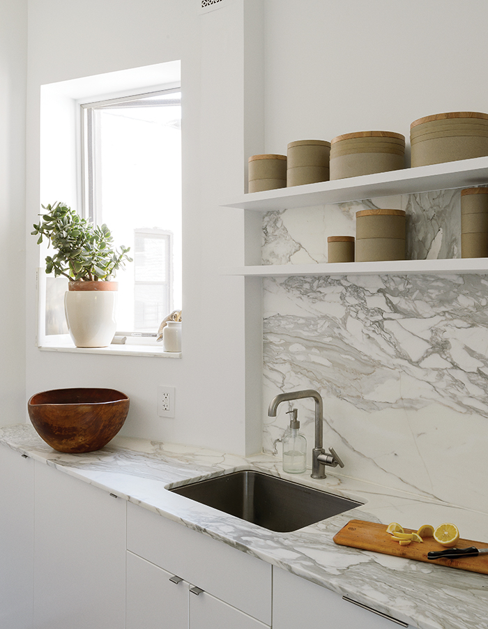 Modern Brooklyn apartment kitchen with Borghini marble countertop and backsplash