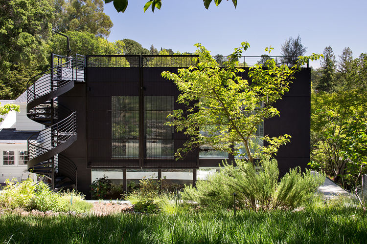 Orinda addition facade and spiral staircase