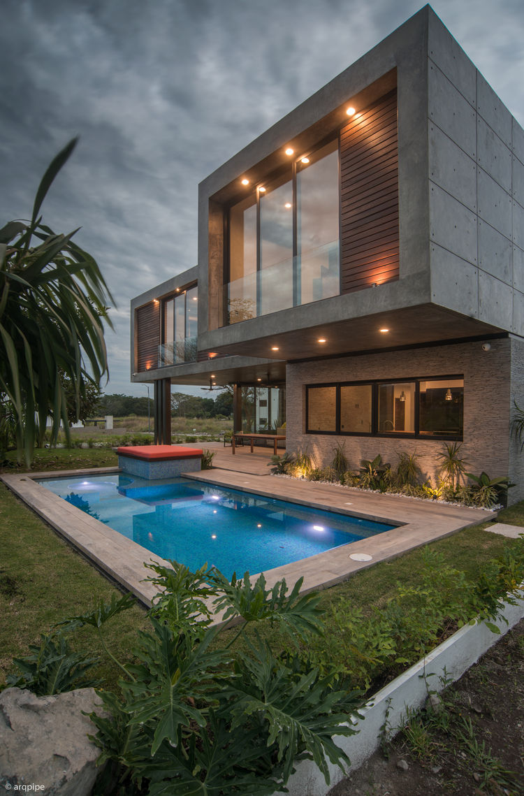 A home in Mexico with a stone and polished concrete facade.