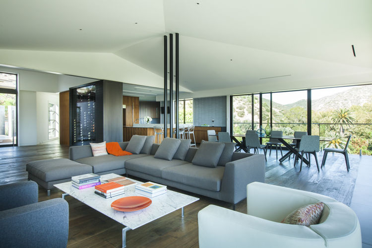 The living area of a beach house features a B&B Italia sofa and Noguchi coffee table.