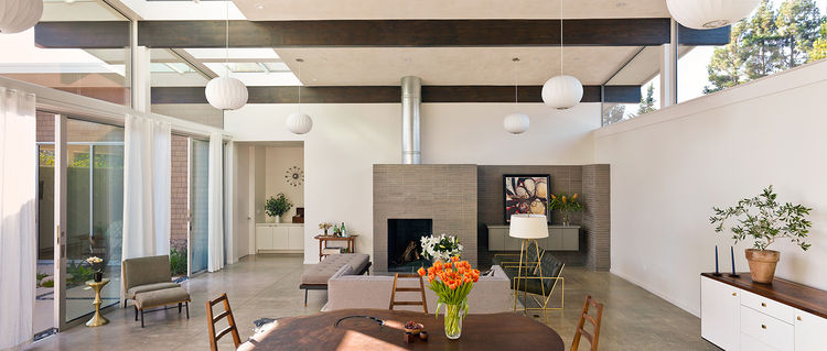 Midcentury-inspired living room with a brick fireplace