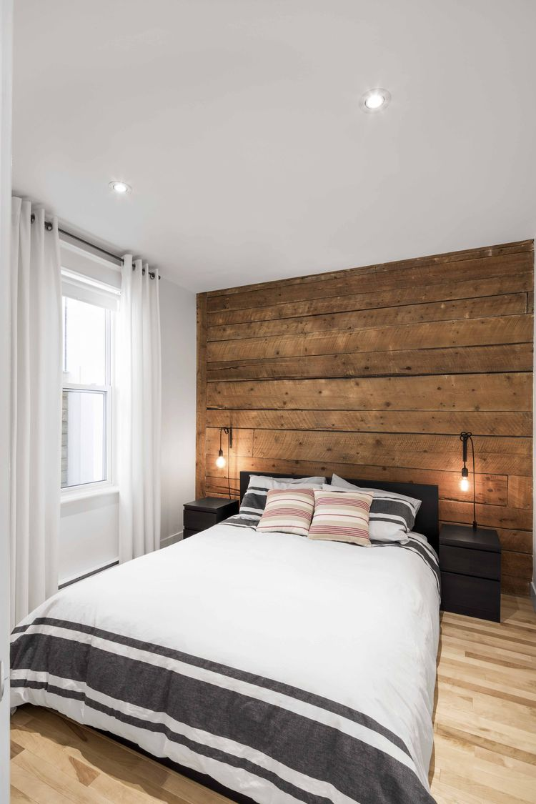 Bedroom with reclaimed wood floor