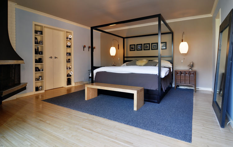 Reclaimed bowling alley wood is used for the bedroom floor.