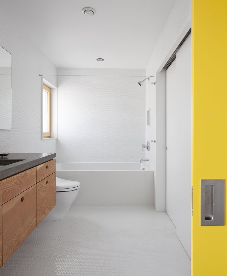 Skidmore Passivhaus bathroom with plywood cabinets
