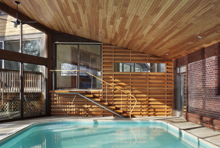 An indoor pool with a Douglas fir interior