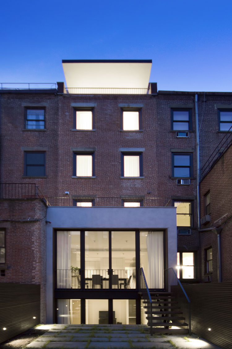 A restored brick facade of a five-story home in New York.