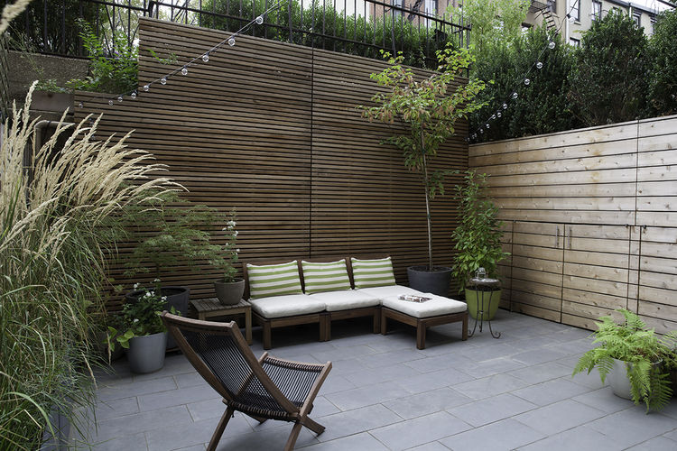 Private garden in Brooklyn with a cedar fence