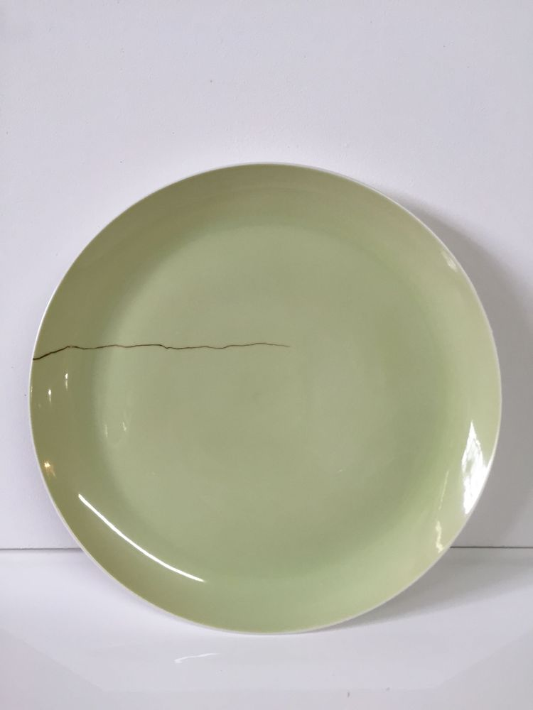 Faux Repair Plates (2000), set of 12, by Ted Muehling, estimated at $4,000–$6,000, up for bid on Paddle8 for Murray Moss auction