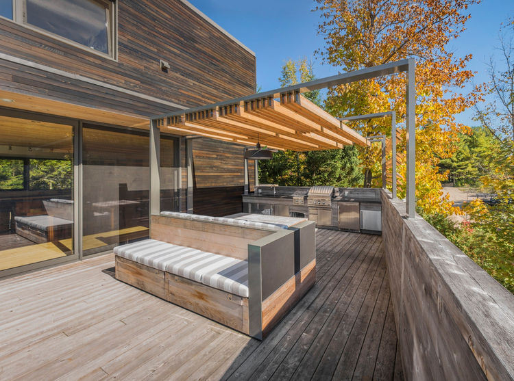 An expansive deck with a pergola