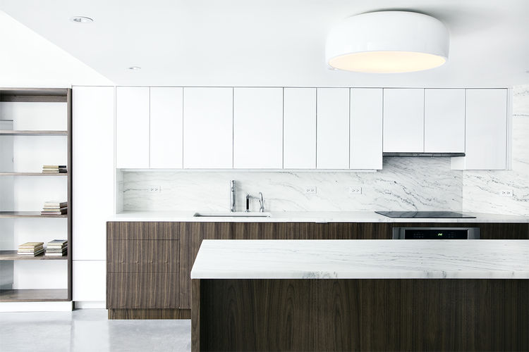A Brooklyn kitchen with white cabinets and open shelving