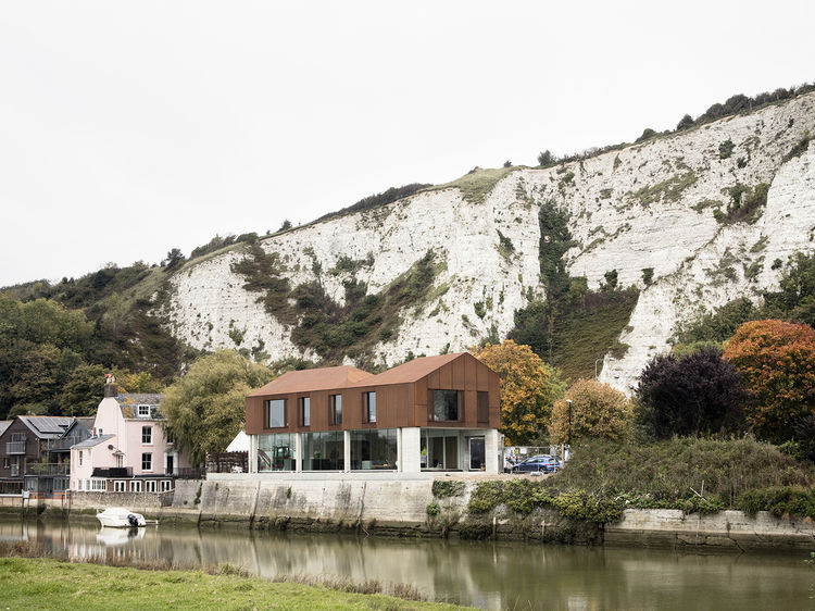 Cor-Ten clad house by the river in East Sussex, England