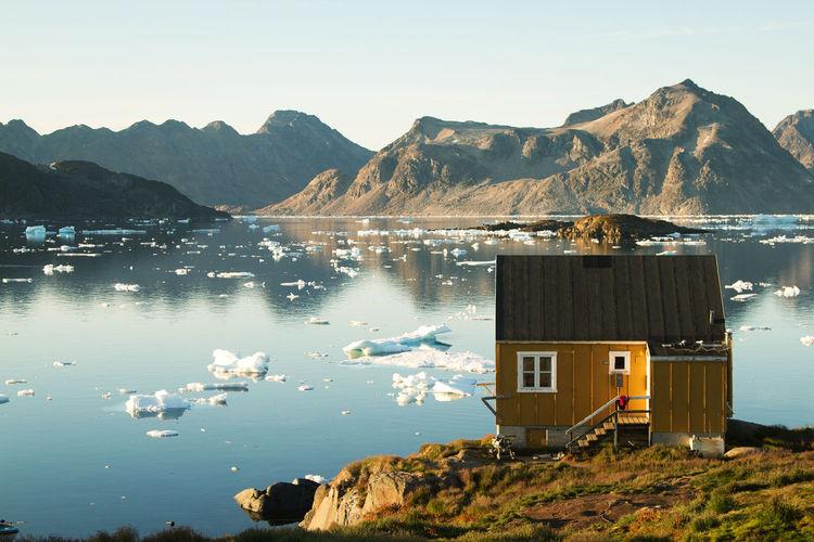 Small cabin in Kulusuk, Greenland overlooking a lake