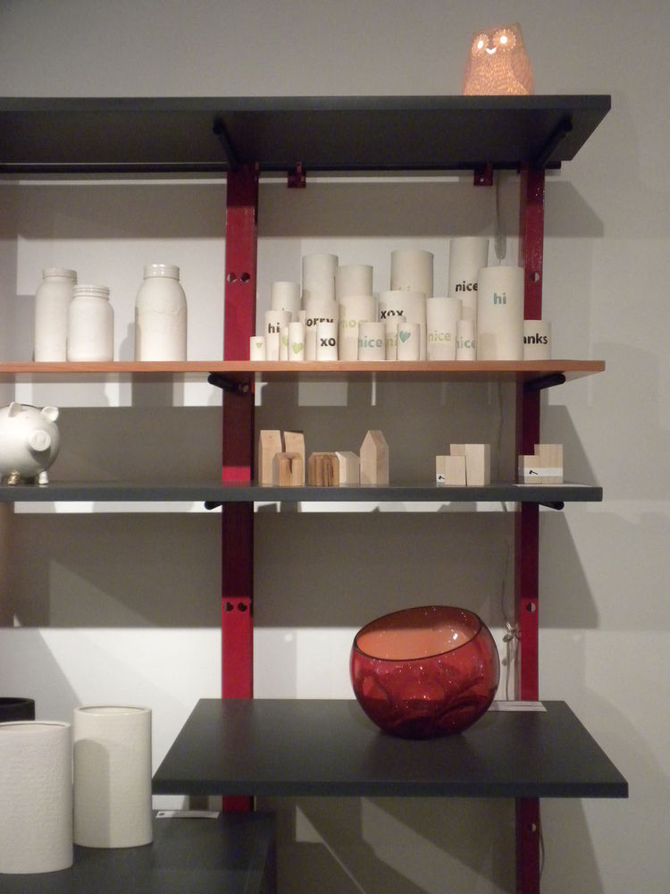 "These shelves are another piece designed and fabricated by Moore for Made. On display are a red Contour Bowl by Calgary native <a href=""http://glassturner.ca/Home.html"">Brad Turner</a>; the salt and pepper sets by Sheridan College students Laura Langford,"
