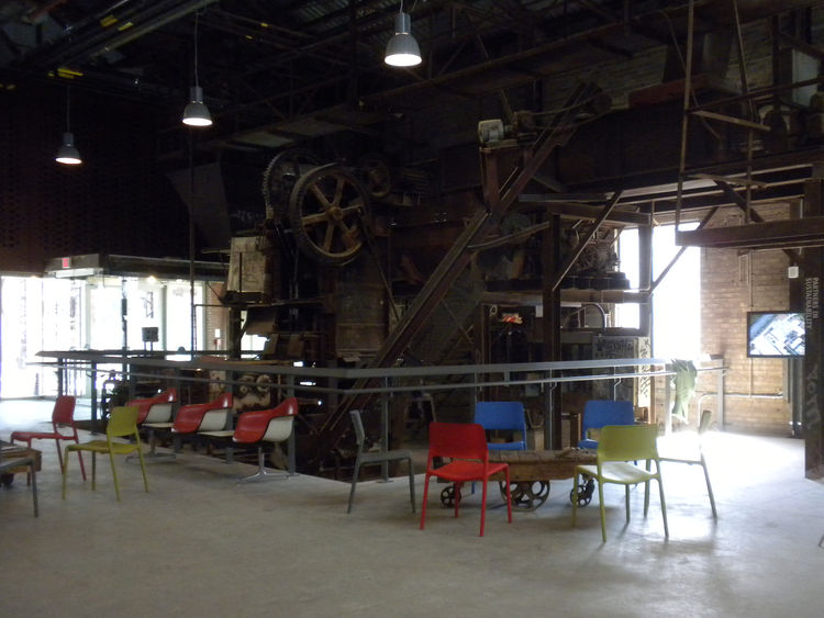 In addition to the visitors reception area and exhibition space, the Welcome Center houses a brick press circa the early 1900s. Workers would have mixed clay with water then fed it into the machine, which would have pressed the wet material into wood mold