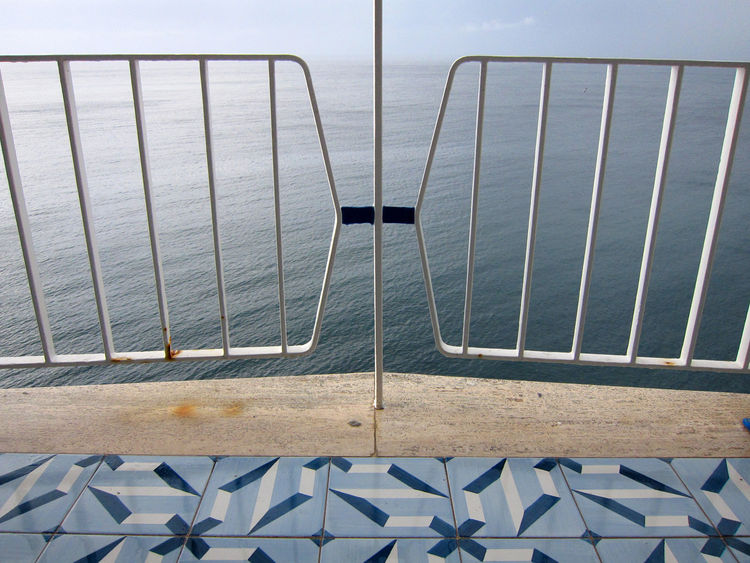A view of the sea through the wrought iron balustrade on our room's balcony.