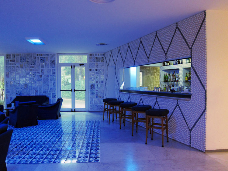 The bar itself is faced with more ceramic pebbles with the lobby's color scheme in reverse. One can only imagine how swinging it must have been in 1962.