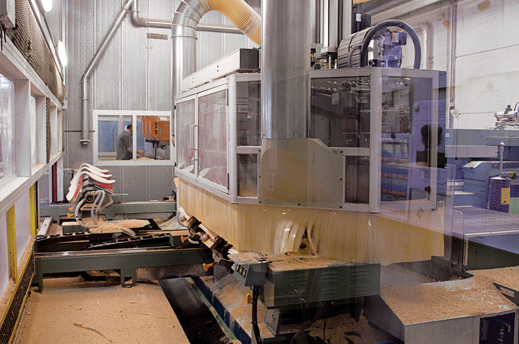 The plywood pieces are fed into the factory's computer controlled machine (CCN, where they are cut into the signature Series 7 silhouette.
