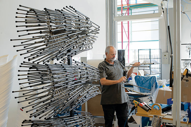 "The legs are attached and one last inspection is done before the chairs are packed and shipped. Read the whole article <a href=""http://www.dwell.com/articles/The-3107-Chair.html"">here</a>. </p>"