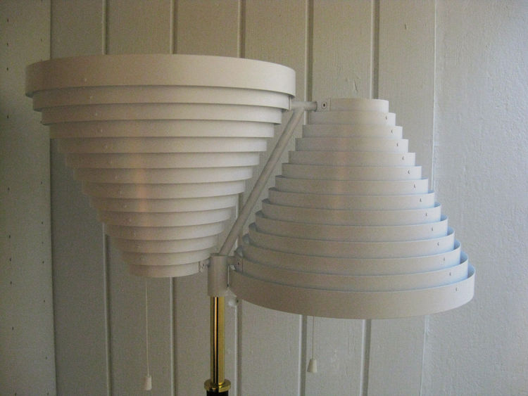 "Aalto's repetitive use of gradually-stepped concentric rings earned this fixture the name ""Lattiavalaisin"" (or Standard lamp). This is model A810."