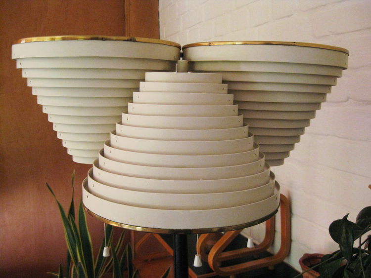 Standard Light A809, a floor lamp in the living area, features three ringed cones.