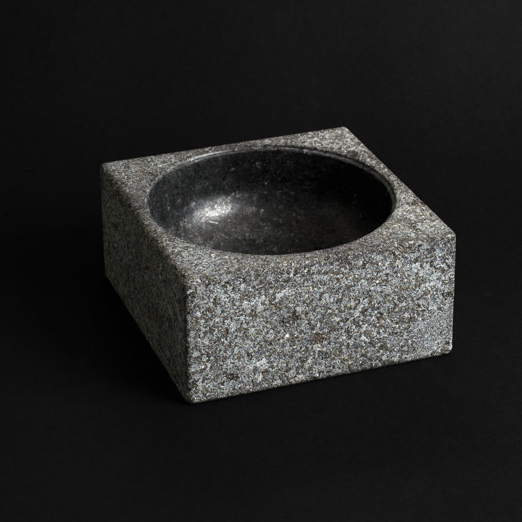 Poul Kjærholm originally designed this granite bowl as a 550-pound ashtray for the city hall in Fredericia, Denmark. This smaller version, which weighs 6.5 pounds, can be used for holding everything from fruit to business cards to jewelry.