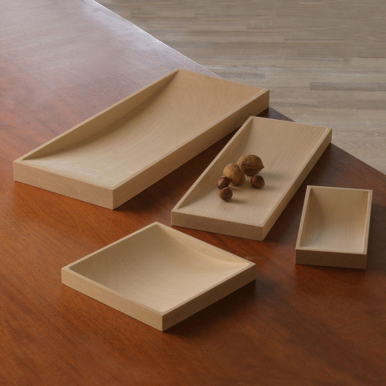 Jørgen Høj's Wooden Trays are made of wood from 100- to 150-year-old maple trees and dried and soap-treated to create a beautiful, light finish. Høj designed the trays in 1953 and more than a half-century later they continue to be timeless in their design
