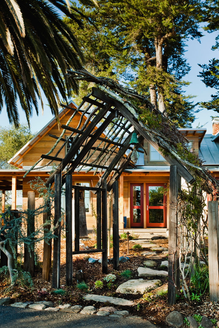 An arbor by artist Jordy Morgan marks the path to the house from the parking area.
