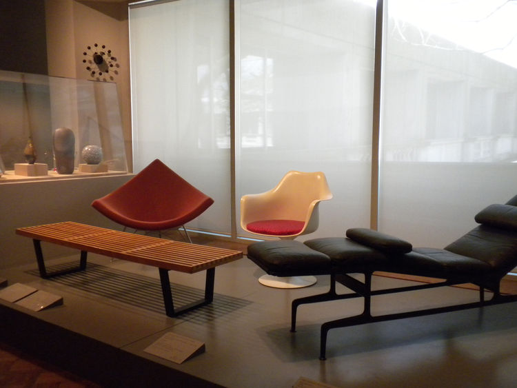 The <i>20th Century American Decorative Arts</i> exhibit featured a slew of mid-century-modern furnishings, including George Nelson's Ball clock, the Nelson Platform Bench, the Nelson Coconut Chair, Eero Saarinen's Tulip Chair with arms, and the Eames Cha