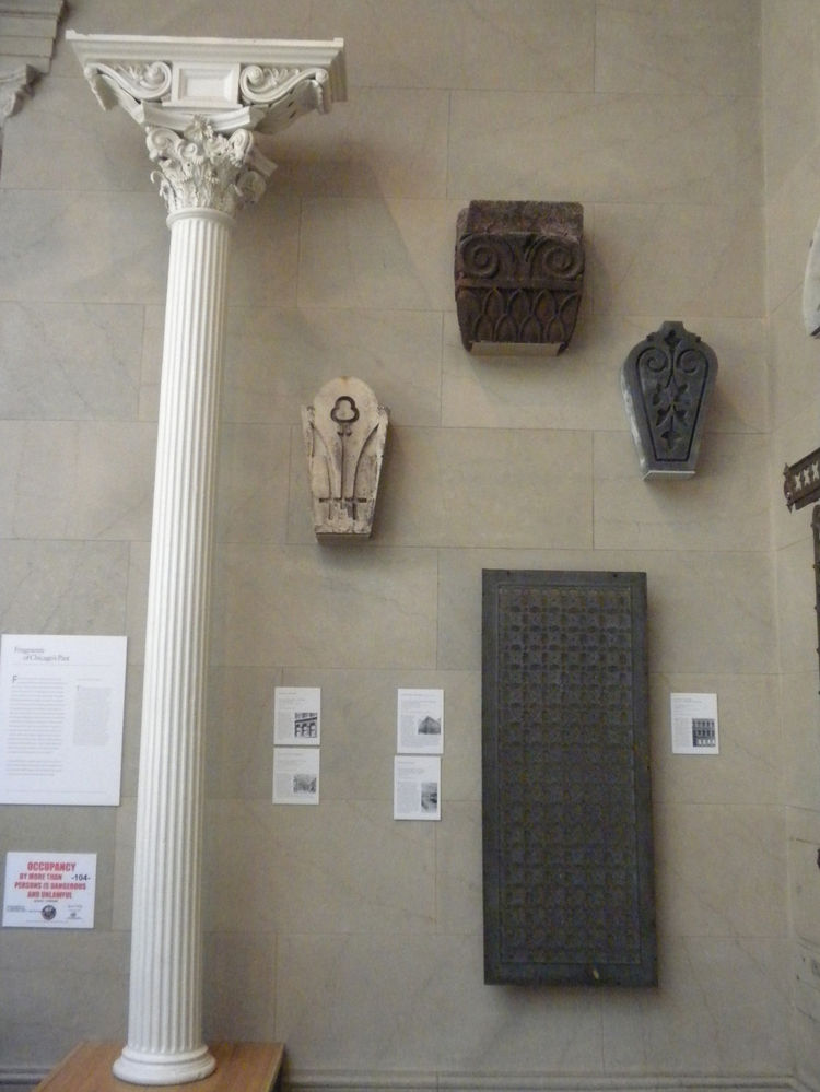 In the <i>Architectural Fragments</i> display in the grand staircase were pieces of iconic and noteworthy buildings, including a plate (bottom right) from the Rookery Building, one of the world's early skyscrapers, built by Burnham and Root in 1886.