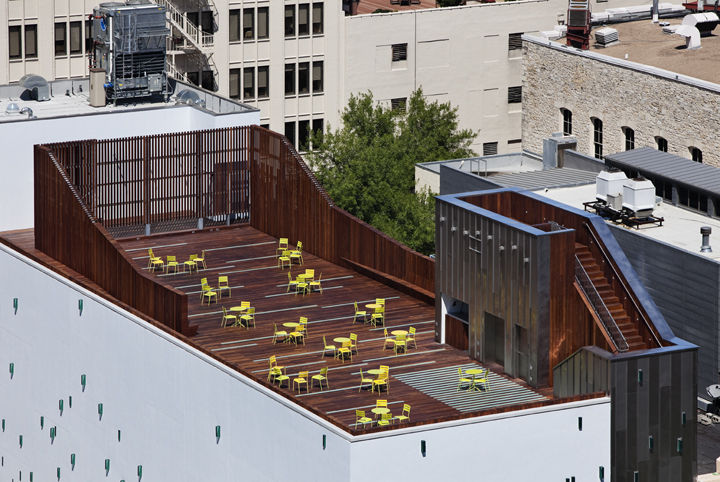 The roof deck, made of Ipe wood and laminated glass light boxes, measures 5,000 square feet and is equipped with a 22-foot-wide movie screen.