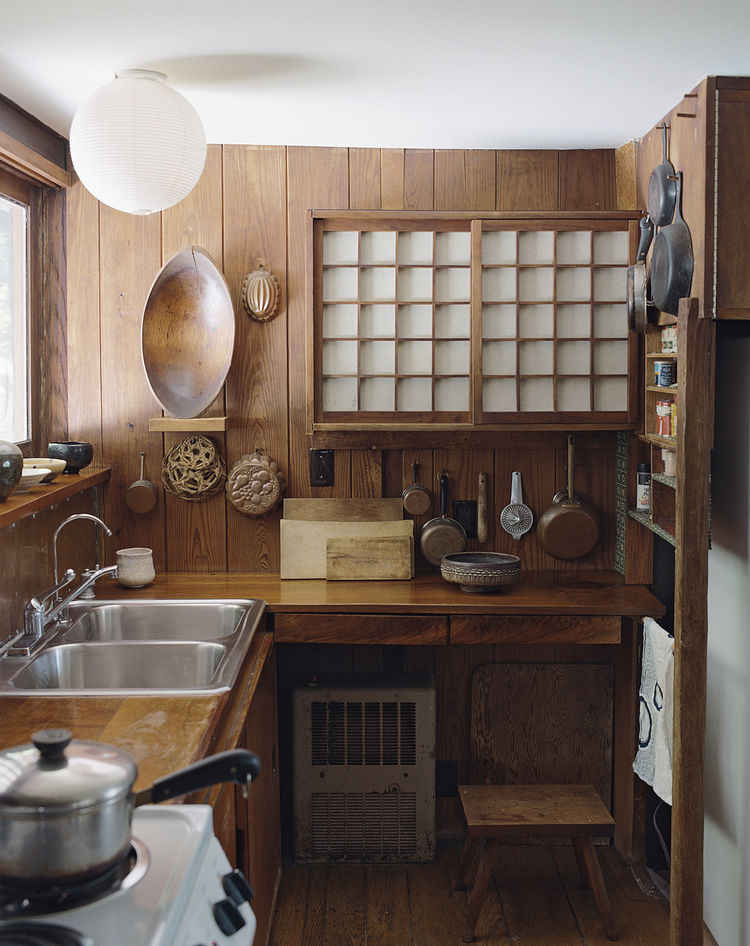 In one house, a small kitchen features a cupboard with sliding shoji screens.