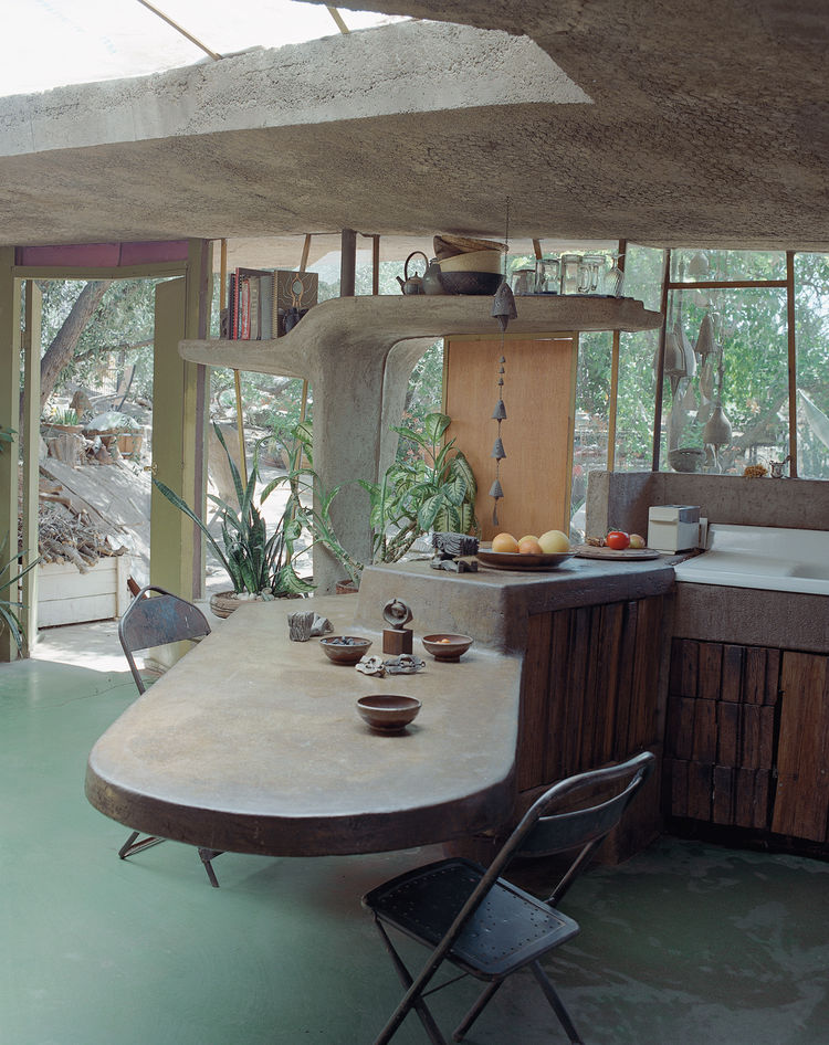 The cantilevered table continues inside Soleri's house. The large windows, doors, and skylights fill the space with light in winter and softly illuminate it through trees' leaves in summer.