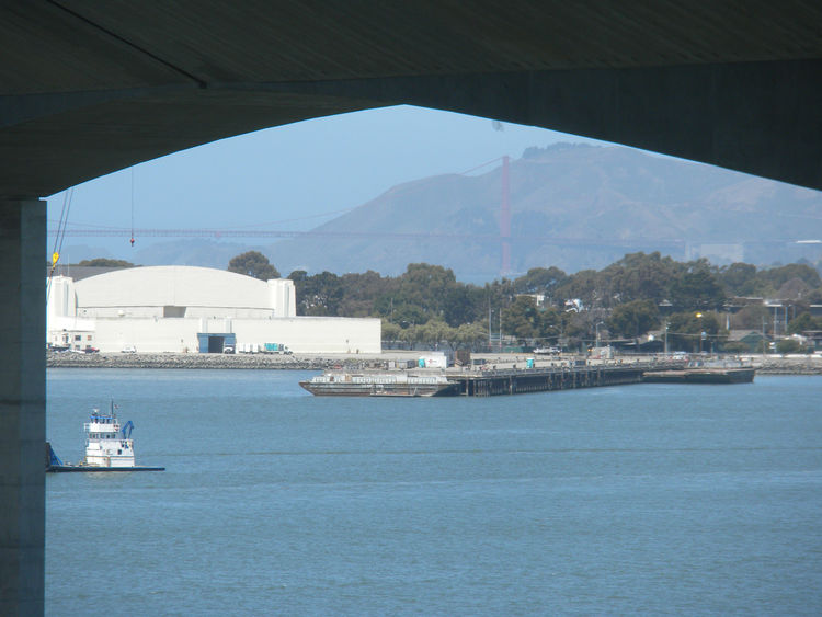 "As we headed up down the stairs into the bridge itself, we got a glimpse of the iconic Golden Gate bridge. Included in the legislature allowing the funding of the new bridge was a requirement that the new Bay Bridge include a ""signature tower."" The 525-fo"