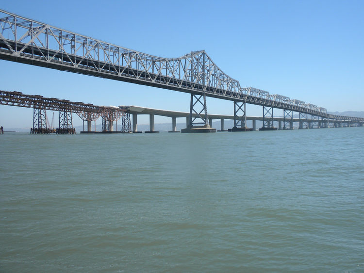 After the new Bay Bridge (the lower of the two pictured) is completed, the old Bay Bridge will slowly be disassembled, likely beginning in 2014. The methodology for removing the parts (including trusses as long as 388 feet) will be up to the winning contr