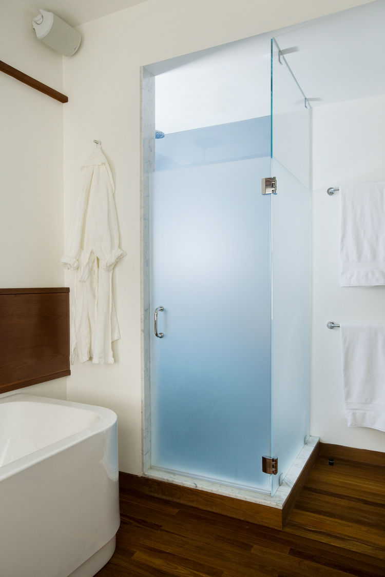The shower is one corner of the renovated bathroom and adds a slash of color—a blue to match the color of the Aegean Sea as the homeowner remembered it after a trip to the Mediterranean.<p></p>Butz and Klug chose towels bars and accessories from <a href=""