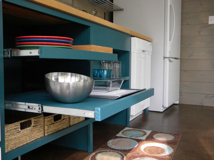 The open, pull-out shelves allow for easy reaching and the gap at the bottom of the drawers makes room for the feet of someone in a wheelchair so they can be closer to the counter.