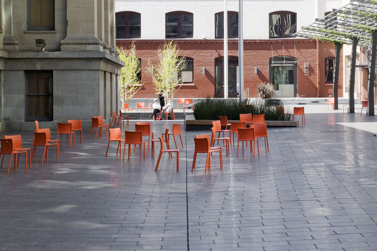 Mint Plaza in San Francisco used to be a highly sketchy back alley. Today it's a vibrant public pedestrian plaza and festival space lined with restaurants and cafes, filled with dozens of movable bright orange chairs and shaded by a vine-covered steel tre