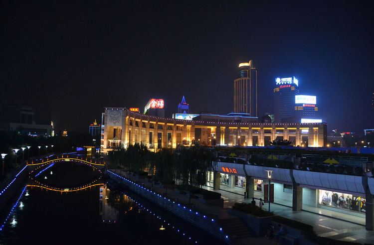 "To close out this week's report from the road, Shahid sent this image of Jinan's canal at night, which ""brought a sense of peace and quiet after a long, hard day of cycling."" Check back soon for another slideshow from Shahid as she bikes from Beijing to S"