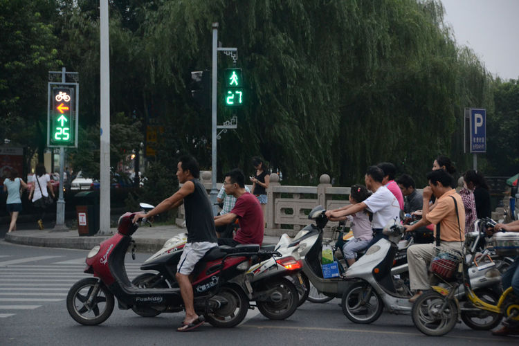 Upon arriving in Suzhou, Shahid ran into traffic in the bike lane as she and fellow two-wheeled travelers waited for the street lights to change.