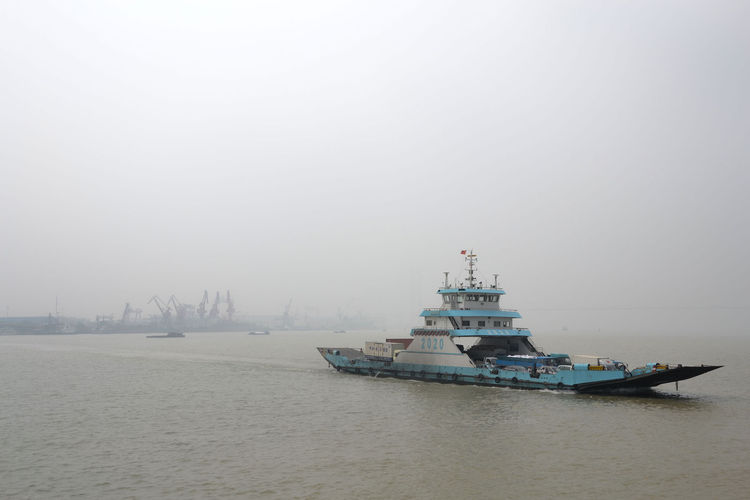 "Bikes are prohibited on the bridge where Shahid planned to cross the Yangtze River. Instead, she rode on a ferry like the one shown in this image. ""The ride was everything but a romantic river cruise thanks to the smog blocking the view across the river,"""