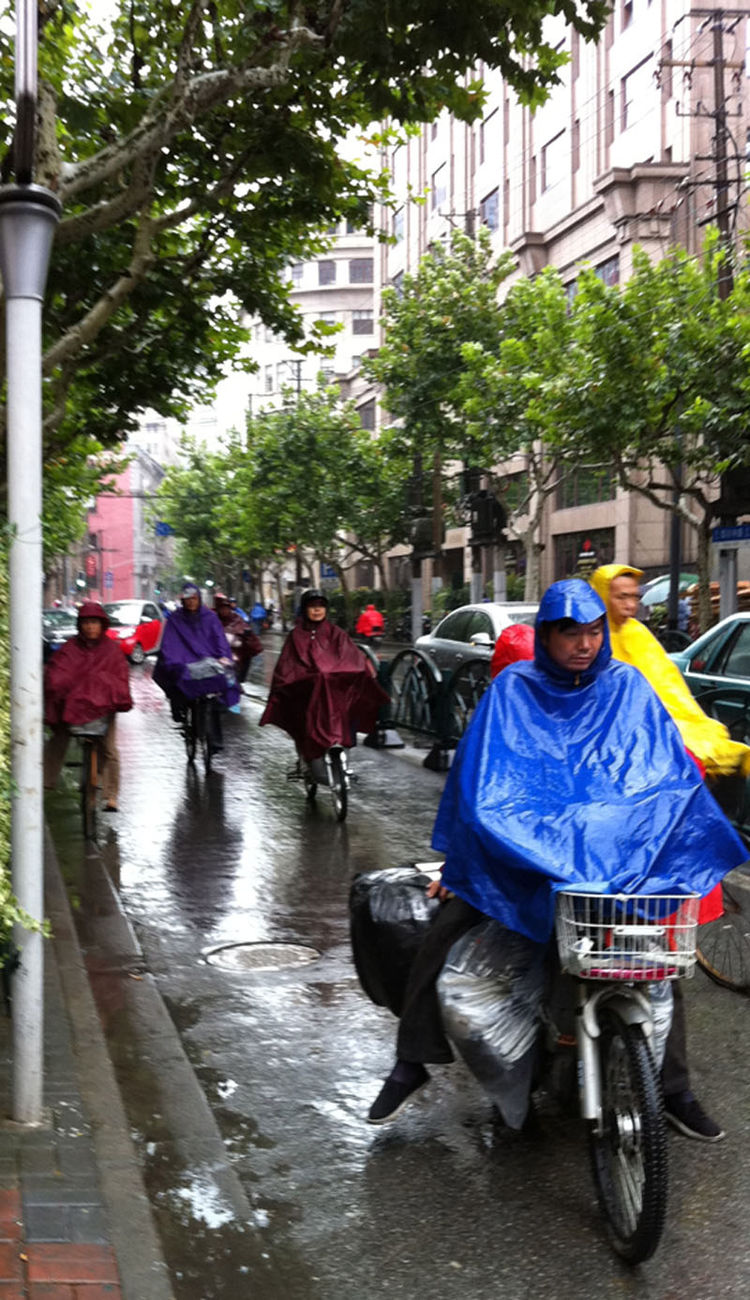 "The rain, however, didn't stop the local cyclists in Shanghai. ""The bike lanes were still just as crowded as in good, sunny conditions,"" Shahid says."