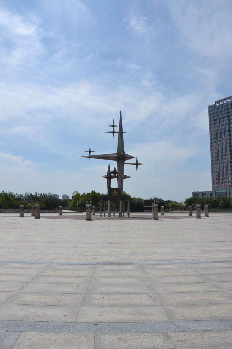 """The landscape architect in me appreciated the openness of this simple hardscaped plaza breaking up the continuity of high-rises and construction sites in Tianjin,"" Shahid says."