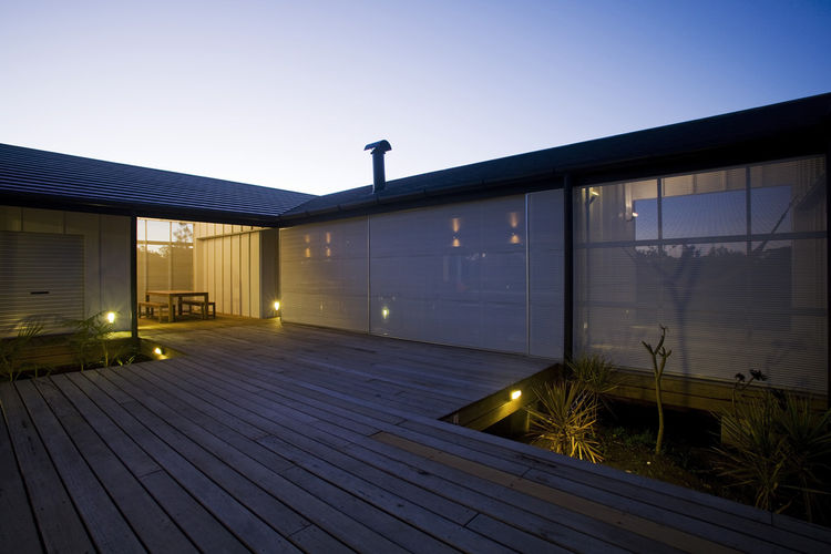 """The same view with the exterior shutters closed. """"The informality and openness of the building means that you can transition from the beach to a hammock with little fuss and without seeing another soul,"""" says James O'Sullivan."""