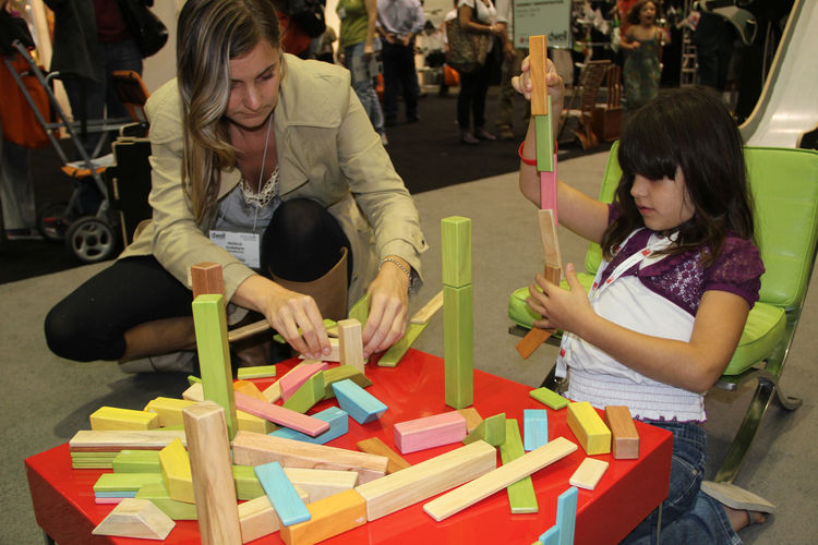 """Blocks from <a href=""""http://www.tegu.com/store/"""">Tegu</a> made from sustainable woods and magnets, which allowed them to easily adhere to the metal table, fascinated many a child. The mini Miesian chairs are from The Sofa Company."""
