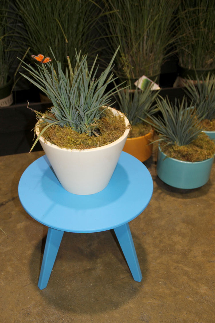 "A delicate but durable round table in blue by <a href=""http://www.lolldesigns.com/welcome.php"">Loll</a>, which makes its furniture out of 100-percent recycled plastic. And it looks much nicer than an old water bottle. The planters, much-coveted on the sho"