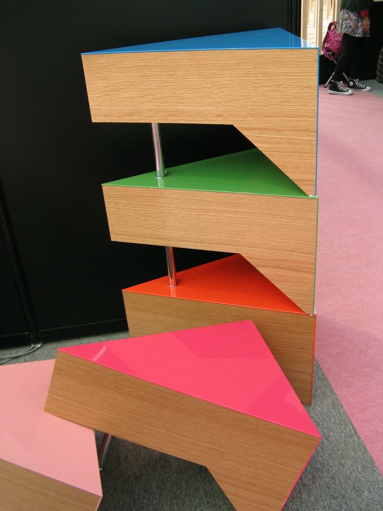 "<a href=""http://www.mizmizdesign.com/top.html"">Kenji Mizuno's</a> stackable Cake Tables add a slice of glossy color to any room. Two pushed together form a rectangle, and eight of this prototype make a whole multi-colored cake."
